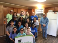 Austin College PDA volunteer team standing with homeowner, Mr. Donald